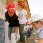 Students working in Oradea, Romania, on the Habitat For Humanity house we built for Caminul Felix