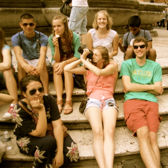 Seniors relax in the sun outside the Pantheon in Rome.