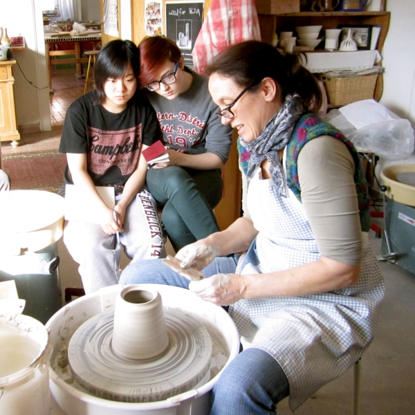 AP Ceramic students watch a demonstration on the weekend workshop with a master potter.