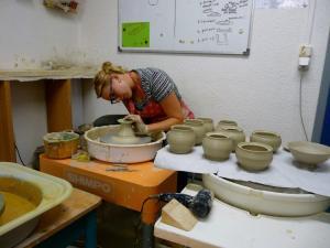 Jennifer throws in her studio.
