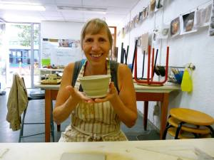 Mom with her finished pot.