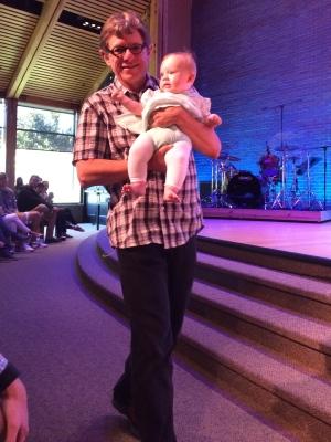 Proud Papa dedicating his first granddaughter at Bethany Community Church.