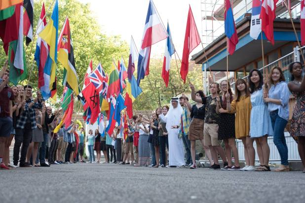 This year's seniors display their flags before Opening Ceremonies. Photo: BFA Communications